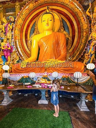 buddha statue inside gangaramaya temple in