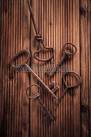 assortment of vintage keys on wooden