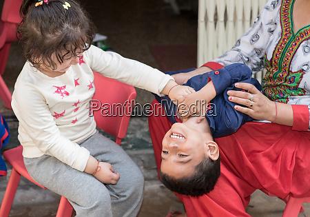 kids having fun at home tickling