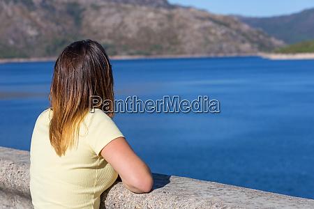 girl enjoying the lake