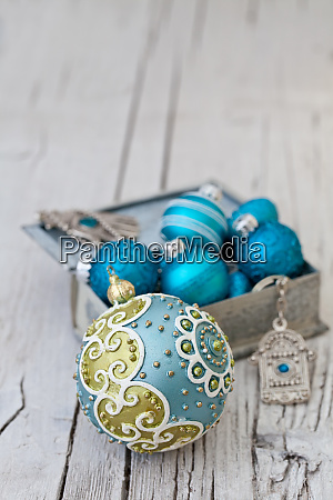 blue turquoise christmas ornaments in box