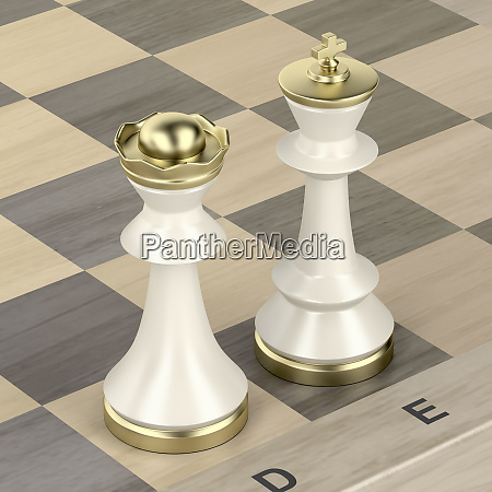 queen and king chess pieces on