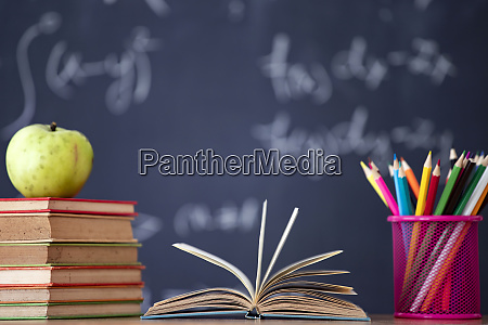 pencils and book and blackboard education