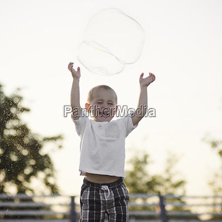 playful happy little boy