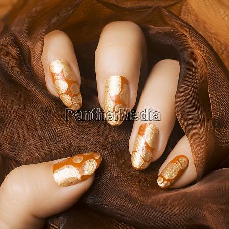 gold orange nails manicure