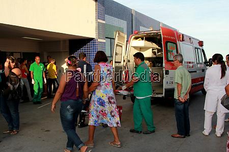 people next to samu ambulance