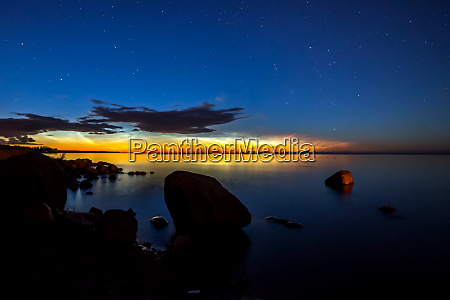 dawn on lake feathered clouds glow