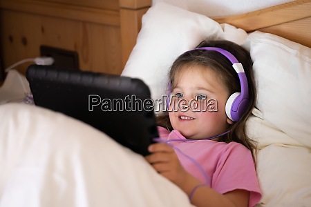 little child girl with tablet