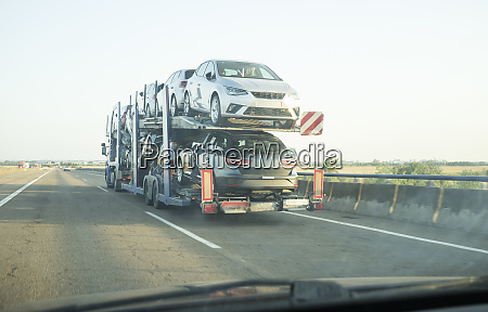 car carrier trailer on divided highway