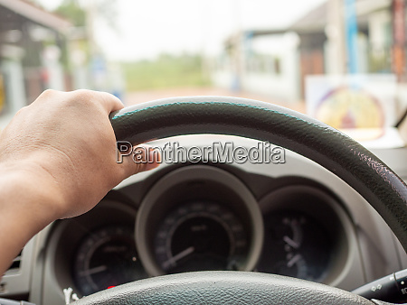 a mans hand holding a car
