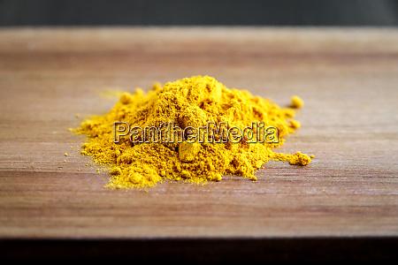 turmeric spice powder on a cutting