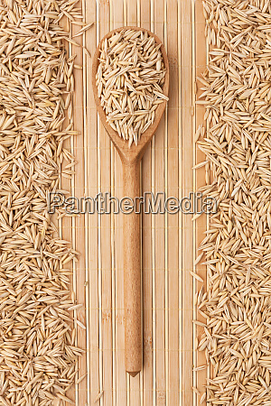 wooden spoon with oats