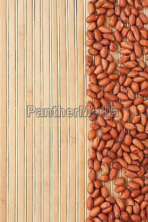 peanut lying on a bamboo