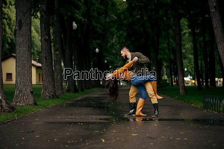 happy love couple dancing in summer