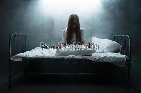 psycho woman screams in bed insomnia