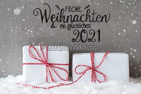two white gifts snow snowflakes cement