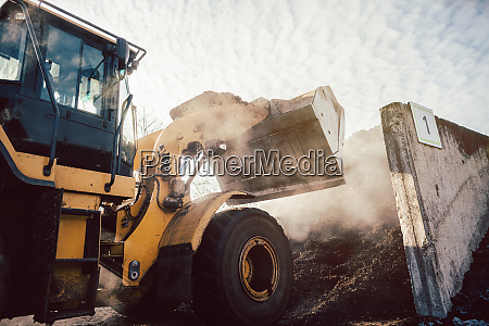 bulldozer piling up biomass for later