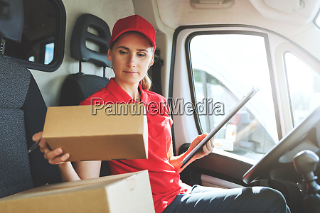 female delivery service worker in red