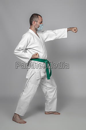 judo practitioner wears a protective mask
