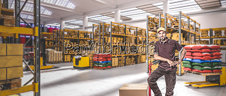 worker in bright industrial warehouse