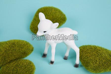 minimal white baby deer and moss