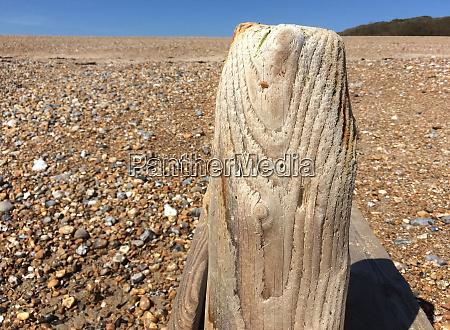 wooden groyne on shingle beach