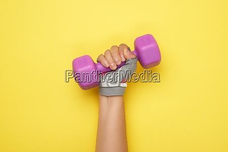 female hand in a pink sports