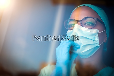 young female medic wearing a mask