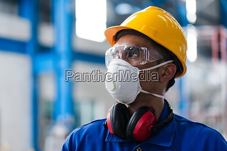 skilled asian worker with protective mask
