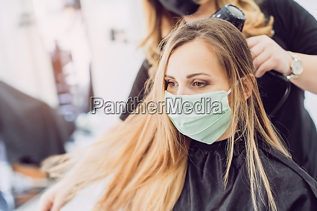 hairdresser and customer waring face mask