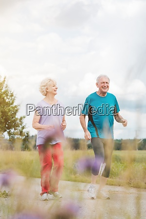 fit and active senior couple running