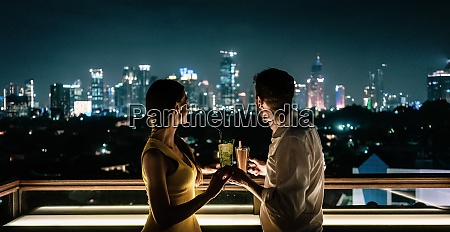 couple having a drink on roof