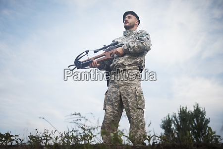 military guard with crossbow