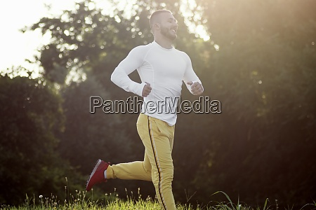 young guy jogging outdoors