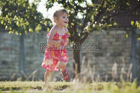 playful dancing little girl