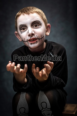 child dressed as skeleton in scary