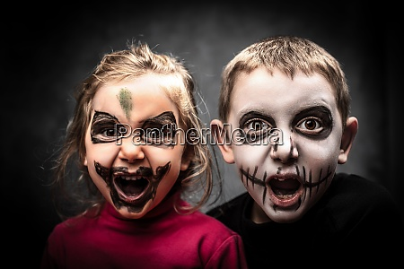 children with face made up for
