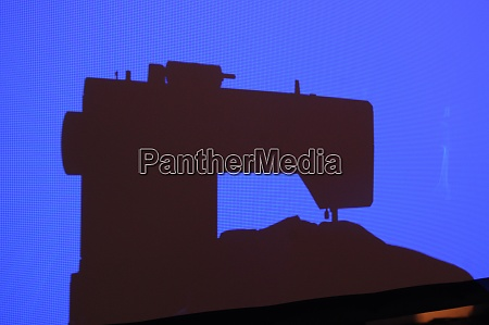 silhouette of a sewing machine on