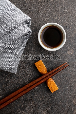 soy sauce in bowl chopsticks and