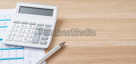 calculator and a pen with copy