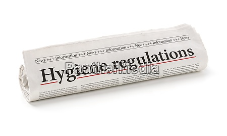 rolled newspaper with the headline hygiene