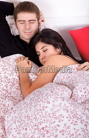 an young couple in bed studio