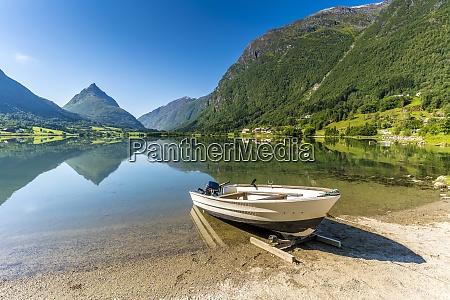 mount eggenipa mirrored in lake bergheimsvatnet