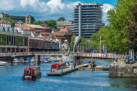 city skyline with canal boats at
