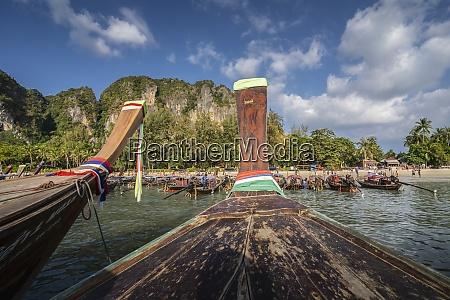 long tail boats on railay beach