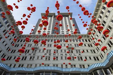 lanterns outside peninsula hotel tsim sha