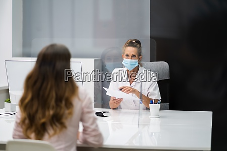 doctor talking to patient at meeting
