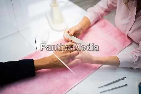 nails cleaning care and manicure service