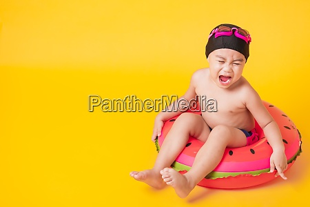 kid hav fun sit in inflatable