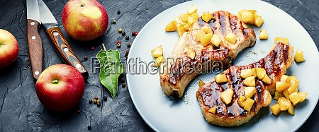 delicious fried meat steak with apple